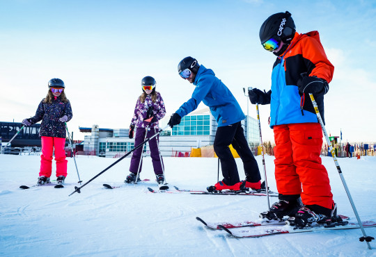 Winsport Ski lesson group of youth with instructor